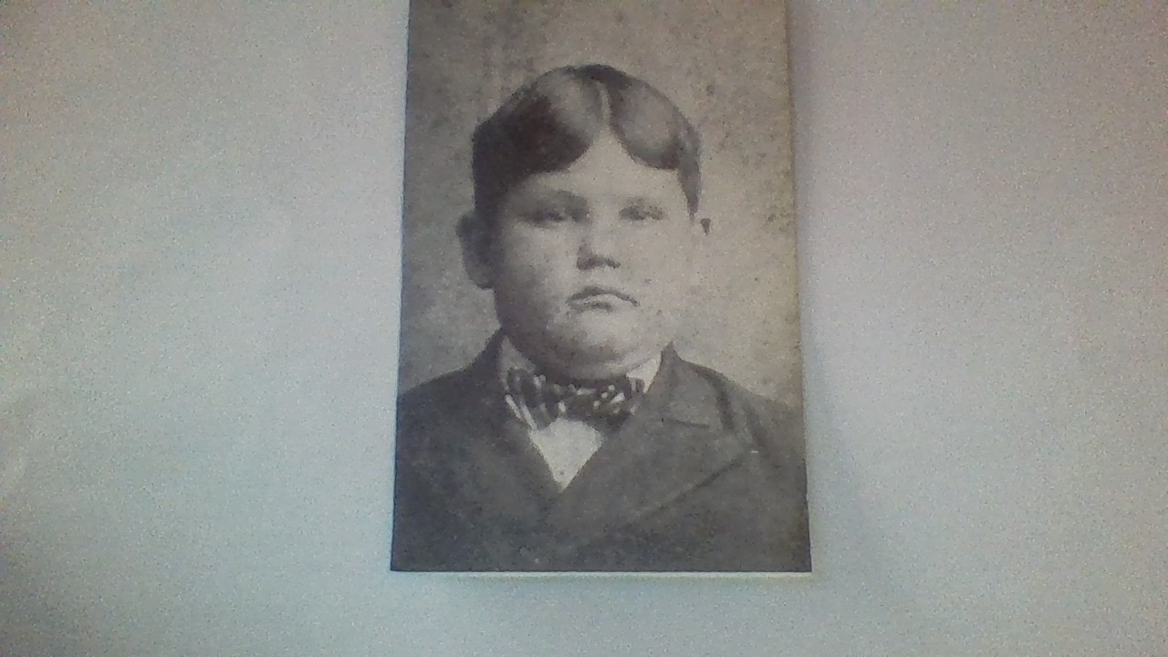Young Norvell as a smart schoolboy.
