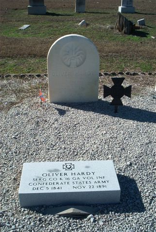 Capt. Oliver Hardy's grave with Veterans' Iron Cross and the erroneous second  memorial stone.
